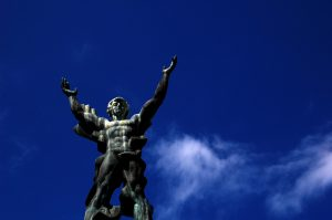 Statue in Puerto Banus with blue sky in the background